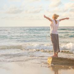 Woman embracing the ocean